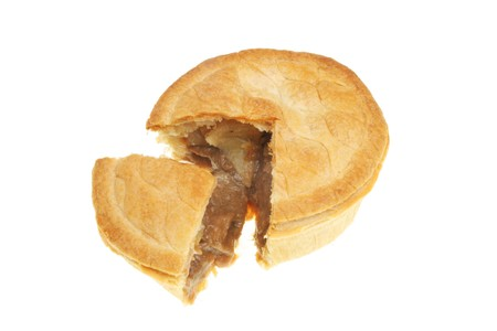 Meat pie with a slice cut out isolated on white