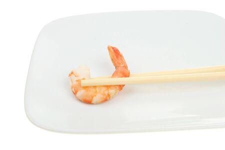 fantail: Single fantail prawn on a plate in chopsticks