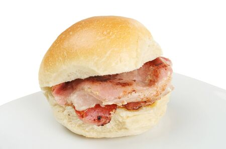 Bacon roll on a plate against a white background