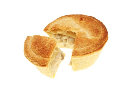 Chicken pie with a slice cut out isolated on white Stock Photo