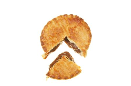 Meat pie with a section cut out isolated on white