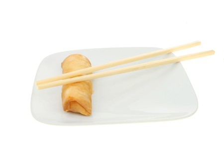 Chinese pancake roll and chopsticks on a white plate Stock Photo - 7598917