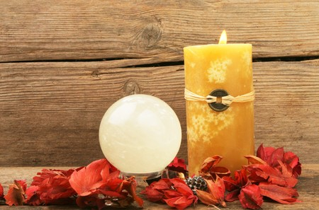 Burning feng shui candle, dried flowers and a crystal ball Stock Photo - 7712578