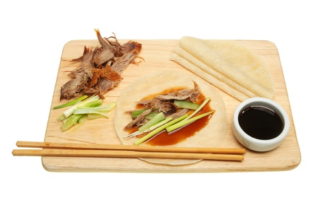 Chinese style crispy duck and pancakes on a board Stock Photo