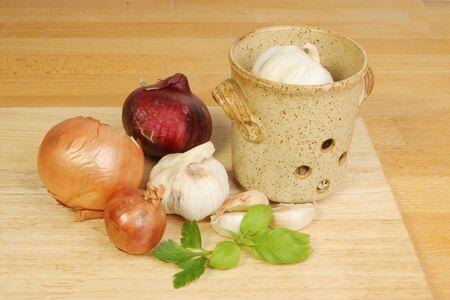 worktop: Onions garlic and herbs on a kitchen worktop