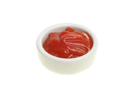 Tomato ketchup in a ramekin isolated on white