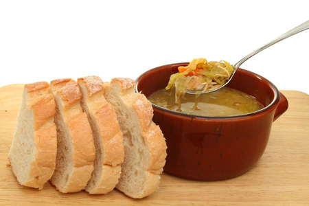 crust crusty: Bowl of chicken and vegetable soup with crusty bread Stock Photo