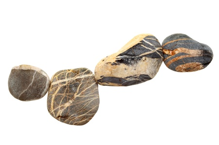 stratified: Line of stratified pebbles isolated against white Stock Photo