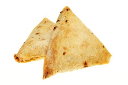 samosa: Two Indian samosa snacks isolated against white