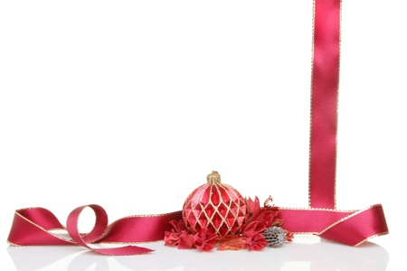 potpourri: Red and gold Christmas bauble decoration with ribbon and potpourri forming a frame or border with white copy space