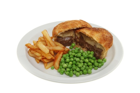 Meat pie chips and peas on a plate isolated against white photo