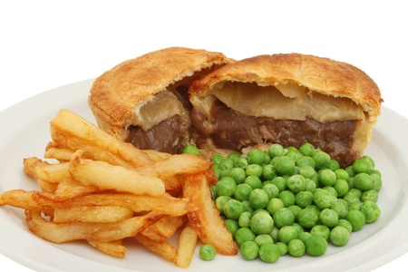 Closeup of meat pie chips and peas on a plate