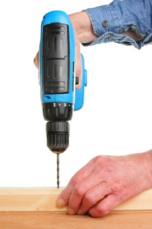Closeup of hands drilling into wood with a cordless drill Stock Photo - 14771258