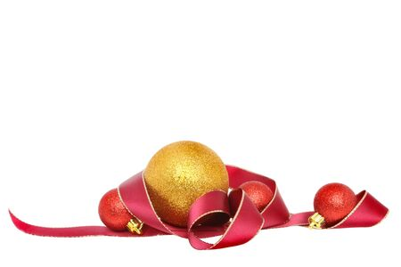 christmas motif: Christmas motif of gold edged red ribbon and gold and red baubles isolated against white