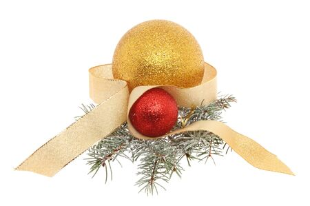 christmas motif: Christmas motif of red and gold baubles ribbon and pine needles isolated against white