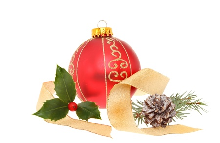 Christmas decoration, bauble with gold ribbon and seasonal foliage isolated against white photo