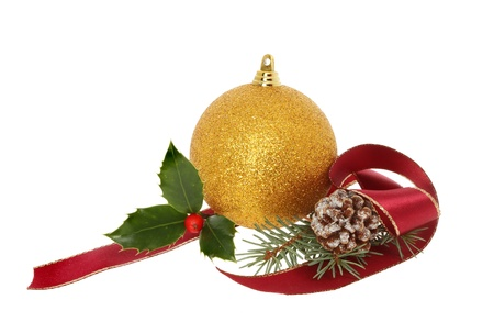 Christmas decoration of gold bauble with holly, ribbon pine cone and leaves photo