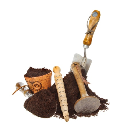 tamper: Garden tools and a pile of soil isolated against white