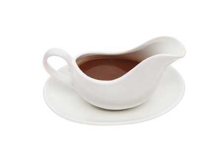 gravy: Gravy in a gravy boat isolated against white
