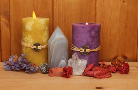 Burning Feng Shui candles, crystals and potpourri against a wood panel background Stock Photo - 18179032