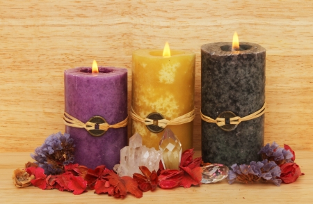 Three burning Feng Shui candles, crystals and potpourri on a wooden background Stock Photo - 18179033