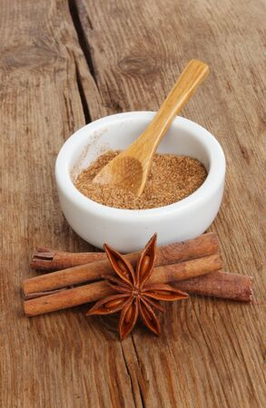 Chineses five spice in a ramekin with star anise and cinnamon sticks on a background of old weathered wood Stock Photo - 18179017