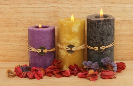 Three burning Feng Shui candles and potpourri against a wooden background Stock Photo - 18179026