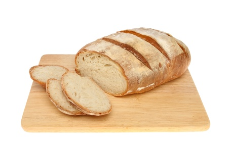 bloomer: Freshly baked bloomer bread loaf with slices on a wooden board isolated against white
