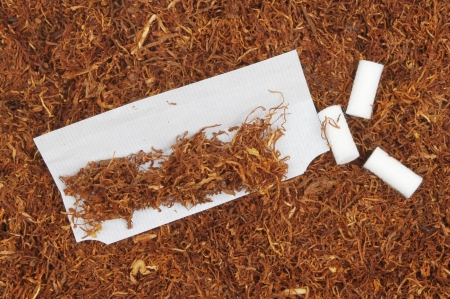 rolling paper: Cigarrete rolling tobacco with a cigarette paper and filters