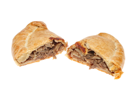 cornish: Cornish pasty cut in two halves showing the meat and vegetable filling isolated against white