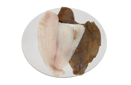 plaice: Plaice fish fillets on a plate isolated against white Stock Photo