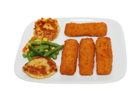 fishfinger: Childs meal of fishfingers, fried potato cakes and mixed vegetables on a plate isolated against white Stock Photo