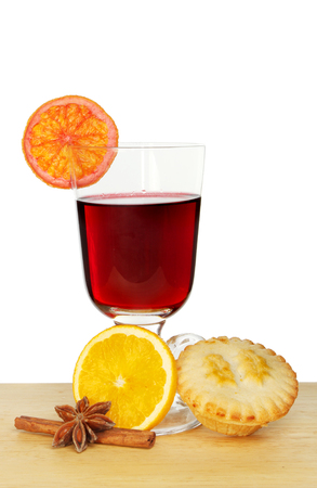 Mulled wine and a mince pie against a white background