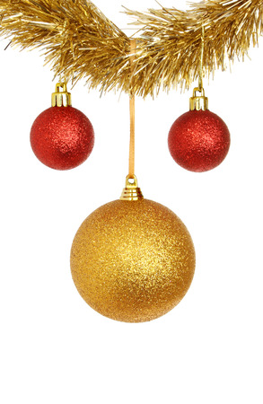 red and gold bauble christmas decorations hanging from tinsel isolated against white stock photo 24180570