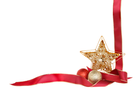 Christmas border, red ribbon, gold glitter star and baubles isolated against white photo