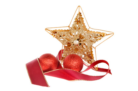 jeweled: Christmas decoration of a gold star with a red ribbon and red baubles isolated against white Stock Photo