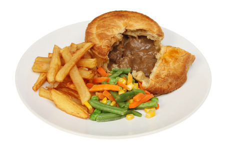 Steak pie chips and mixed vegetables on a plate isolated against white photo