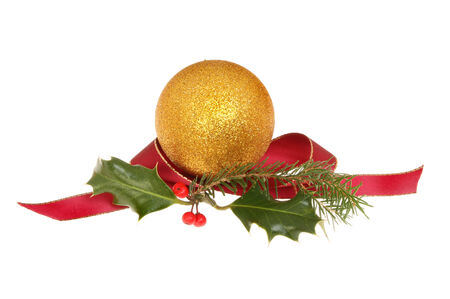 Christmas decoration, gold bauble with holly, pine needles and a red ribbon isolated against white photo