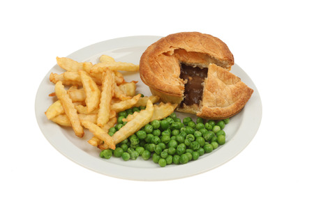 crinkly: Meat pie chips and peas on a plate isolated against white