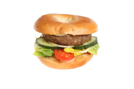 garnish: Beef burger with salad garnish in a bagel isolated against white
