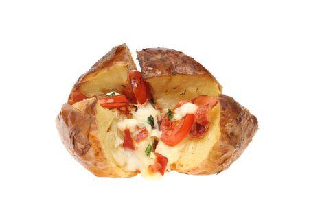 baked: Baked potato with mozzarella cheese, pancetta, tomato and basil isolated against white Stock Photo