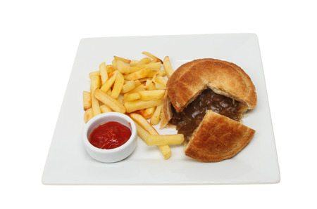 ramekin: Steak pie, chips with tomato ketchup in a ramekin on a square plate isolated against white