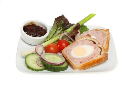 chutney: Pork and egg pie with salad and chutney on a plate isolated against white Stock Photo