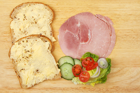 multi grain sandwich: Ham salad sandwich ingredients on a wooden board
