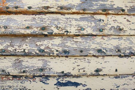 weathered: Old weathered wood panel with peeling paint