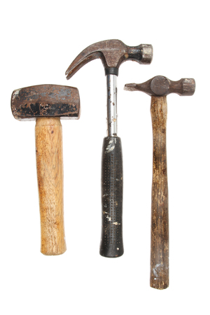 tack: Three hammers, lump,claw and tack hammer isolated against white
