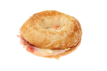 toasted: Toasted ham and cheese bagel isolated against white
