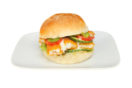 bap: Fish fingers with salad and tartar sauce in a soft bread roll on a plate isolated against white Stock Photo