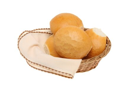 serviette: Crusty bread rolls in a basket with a serviette isolated against white Stockfoto