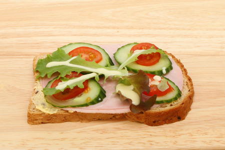 multi grain sandwich: Ham and salad open sandwich with salad cream on a wooden board Stock Photo